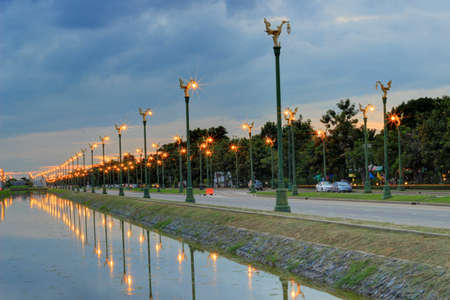 thanon: twilight sky at Thanon Utthayan(Aksa Road), Bangkok,Thailand-one of the most beautiful roads in Thailand. Along both sides of the road are 979 lamp posts decorated with the Thai phoenix Editorial