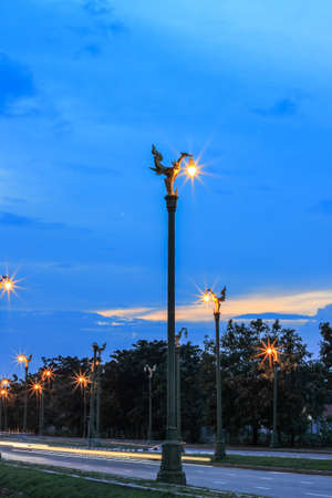 twilight sky at Thanon Utthayan(Aksa Road), Bangkok, Thailand-one of the most beautiful roads in Thailand.Along both sides of the road are 979 lamp posts decorated with the Thai phoenix