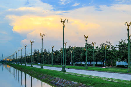 thanon: Evening sky at Thanon Utthayan(Aksa Road),Bangkok,Thailand-one of the most beautiful roads in Thailand.Along both sides of the road are 979 lamp posts decorated with the Thai phoenix