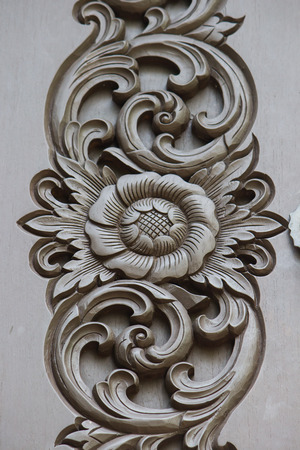 Thai wood carving on the door of Thai house. Stock Photo