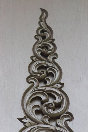 wood carving door: Thai wood carving on the door of Thai house. Stock Photo