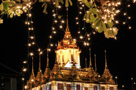 majesty: Night scene of Loha Prasat at Wat Ratchanaddaram Woravihara(buddhist temple in Bangkok,Thailand) during His Majesty the Kings birthday celebration.