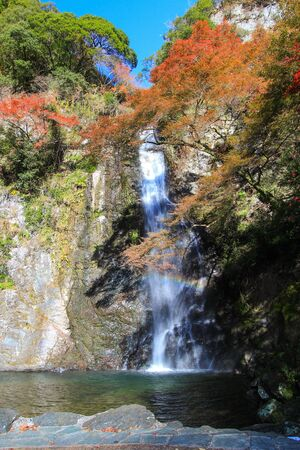 autumn at Minoo Waterfall,Osaka,Japan.This waterfall is Minoo parks main natural attraction,with a height of 33 meters. Stock Photo