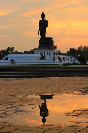 nakhon pathom: Reflection shadow of Buddha statue at Phutthamonthon (Buddhist park in Phutthamonthon district, Nakhon Pathom Province of Thailand) Stock Photo