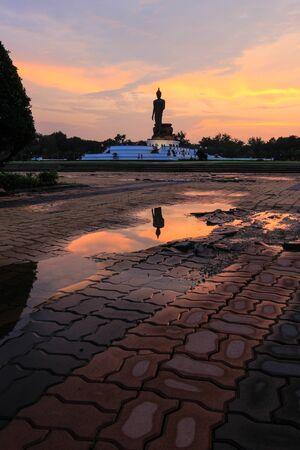 nakhon: Reflection shadow of Buddha statue at Phutthamonthon (Buddhist park in Phutthamonthon district, Nakhon Pathom Province of Thailand) Stock Photo