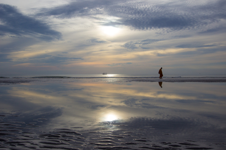khan: morning life at Hua Hin beach,Prachuap Khiri Khan Province,Thailand.With beautiful sky and beach.