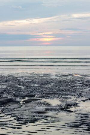 khan: sunrise at Hua Hin,Prachuap Khiri Khan Province,Thailand.With beautiful sky and beach. Stock Photo