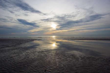 hua hin: sand waves with reflection shadows of morning sun and sky at Hua Hin,Prachuap Khiri Khan Province,Thailand.