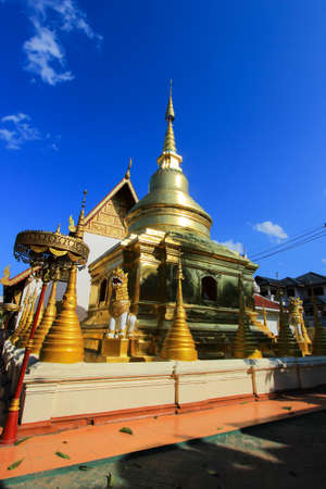 Golden chedi or pagoda  behind the ubosot of Wat Pra Singh.-a Buddhist temple in Chiang Rai Province, northern Thailand. Stock Photo