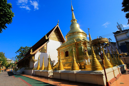 pra: Golden chedi or pagoda  behind the ubosot of Wat Pra Singh.-a Buddhist temple in Chiang Rai Province, northern Thailand. Stock Photo