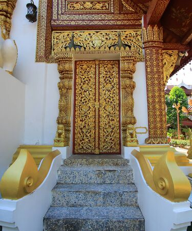 pra: beautiful wood carvings at the Ubosoth of Wat Pra Singh in classic Lanna style.It is a Buddhist temple in Chiang Rai Province, northern Thailand. Stock Photo