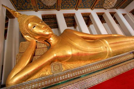 reclining: Reclining Buddha statue at Wat Rajorasaram, Chomthong, Bangkhunthien, Bangkok, Thailand. This is a public temple. Stock Photo