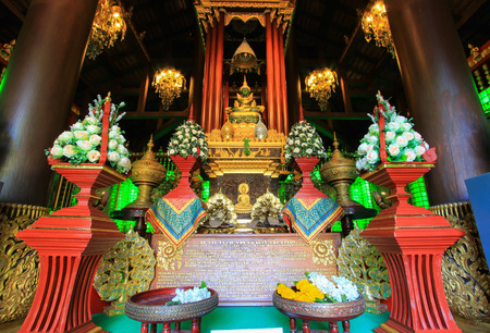 jade buddha temple: Chiang Rai Jade Buddha in Haw Phra Yok,Wat Phra Kaew,Chiang Rai,Thailand.Non English texts are the worship words.