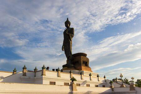 nakhon pathom: blue sky at  Phutthamonthon(Buddhist park in Phutthamonthon district,Nakhon Pathom Province of Thailand)Non-English language at the base is the name of the statue Phra Si Sakkaya Thotsaphonlayan Stock Photo