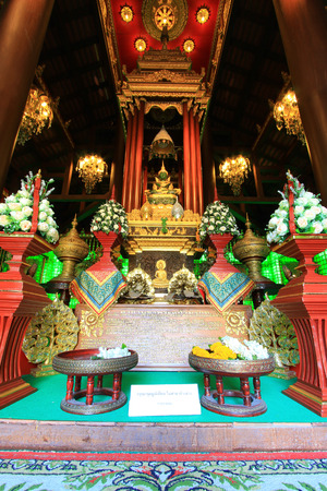 jade buddha temple: Phra Yok Chiang Rai or Chiang Rai Jade Buddha in Haw Phra Yok,Wat Phra Kaew,Chiang Rai,Thailand.Non English texts are the worship words.