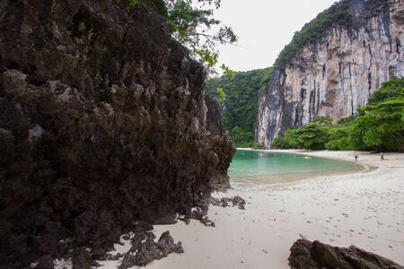 white sand: Limestone cliffs,white sand and pretty clear water at Hong Islands,Krabi Province,Southern Thailand