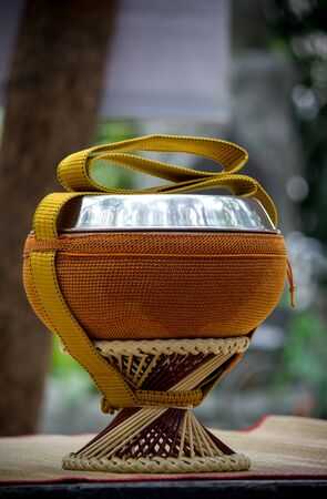Almsbowl used by Buddhist monks for going on almsround.The bowl is usually stored and carried in a cloth or crocheted bag, both for protection and ease of carrying.