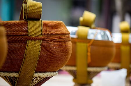 almsgiving: Almsbowls used by Buddhist monks for going on almsround.The bowl is usually stored and carried in a cloth or crocheted bag, both for protection and ease of carrying. Stock Photo