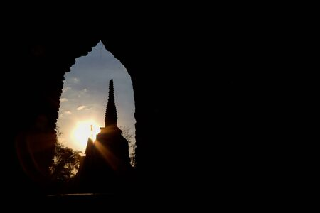 si: Ruined stupas in Ayutthaya Historical Park during sunset.Located in Phra Nakorn Si Ayutthaya,Thailand and now a UNESCO World Heritage Site.