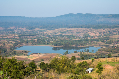 Thin fog,hills cascading beautifully and Rattanai reservoir as seen from the Viewpoint opposite to  district office of Khao Kho,Phetchabun Province,northern Thailand.