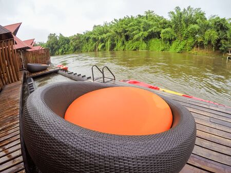Cozy atmosphere and natural touch along Kwai Noi River,Sai Yok,Kanchanaburi,Thailand.With sofa bed on the balcony of the raft house.