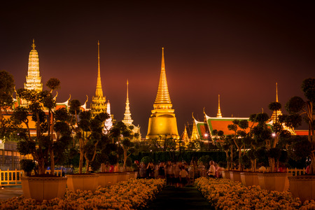 nightscape of Grand Palace(Wat Phra Kaew) with Marigold flowers in the foreground,Bangkok,Thailand Stock Photo