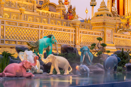 Exhibition on royal cremation ceremony of His Majesty King Bhumibol Adulyadej,Sanam Luang Ceremonial Ground,Bangkok,Thailand on November7,2017:Sculptures of mythical creatures in Himmaphan(Himavanta) Forest surround the base of Royal Crematorium(imaginary