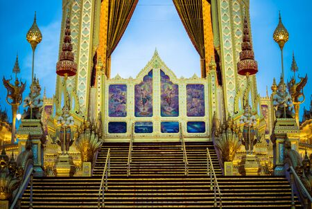 Exhibition on royal cremation ceremony of His Majesty King Bhumibol Adulyadej,Sanam Luang Ceremonial Ground,Bangkok,Thailand on November7,2017:Fire screen at the Royal Crematorium consists of paintings featuring the god Vishnu and royally initiated projec Editorial