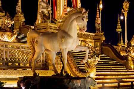 Exhibition on royal cremation ceremony of His Majesty King Bhumibol Adulyadej,Sanam Luang Ceremonial Ground,Bangkok,Thailand on November7,2017:Sculptures of mythical creatures surround the Royal Crematorium