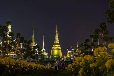 Exhibition on royal cremation ceremony of His Majesty King Bhumibol Adulyadej,Sanam Luang Ceremonial Ground,Bangkok,Thailand on November7,2017:Grand Palace & Wat Phra Kaew with Marigold flowers in the foreground during the ceremony. Editorial