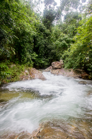 Small waterfall with cryatal clear water stream near the campground on the way to Pitugro Waterfall(Petro Lo Su) in Umphang Wildlife Sanctuary,Tak Province,Thailand.