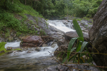 Small waterfall with crystal clear water stream near the campground on the way to Pitugro Waterfall(Petro Lo Su) in Umphang Wildlife Sanctuary,Tak Province,Thailand.
