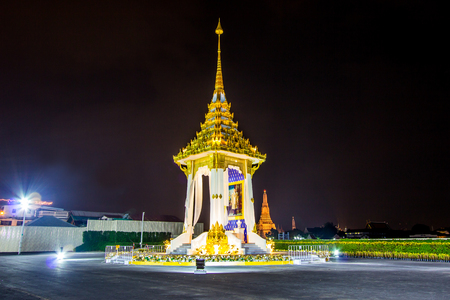 Bangkok,Thailand on November13,2017:Night scene of Replica of the Royal Crematorium for the Royal Cremation of His Majesty King Bhumibol Adulyadej at Nakrapirom Park in Rattanakosin Island on the riverbank of Chao Phraya River,with Wat Arun Ratchawararam