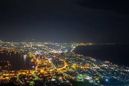 Hakodate, Hokkaido, Japan on April 28, 2018: Fantastic views of Hakodate city from Mount Hakodate. One of Japan's three best night views. 스톡 콘텐츠 - 133266484