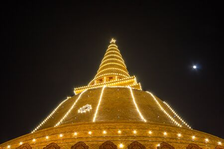 Nakhon Pathom, Thailand on November 20, 2018 : Light up Phra Pathom Chedi. The beautiful Lanka-style bell-shaped Chedi. The biggest chedi in Thailand.