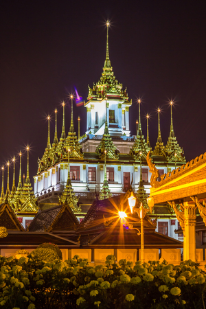 Night scene of Loha Prasat at Wat Ratchanaddaram Woravihara(buddhist temple located in Phra Nakhon district,Bangkok,Thailand. Also called the 'Metal Castle')