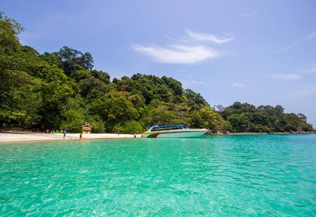 Kawthoung, Myanmar - April 6, 2018 : Crystal clear sea water,pleasant and shady atmosphere at Flower Island