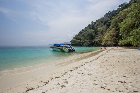 Kawthoung, Myanmar - April 6, 2018 : Crystal clear sea water, pleasant and shady atmosphere at Flower Island