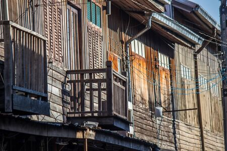 Old wooden houses along walking street(Chai Khong Road) in Chiang Khan,Loei,Northeastern Thailand. Фото со стока