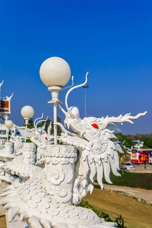 Lamp posts decorated with beautiful white dragon sculptures at Wat Huay Pla Kang,Rimkok district,Chiang Rai Province,Northern Thailand. 스톡 콘텐츠