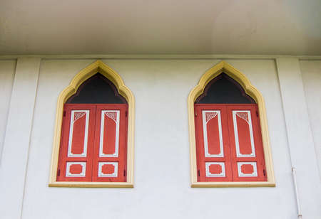 Phasi Charoen district,Bangkok,Thailand on May29,2020:Thai style windows at Wat Paknam Phasi Charoen. 에디토리얼