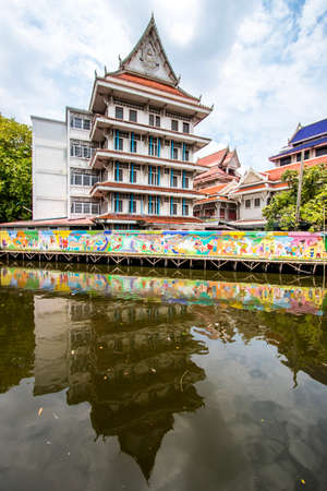 Phasi Charoen district,Bangkok,Thailand on May 29,2020:Waterside scene with beautiful wall paintings along Phasi Charoen Canal at Wat Paknam Phasi Charoen.