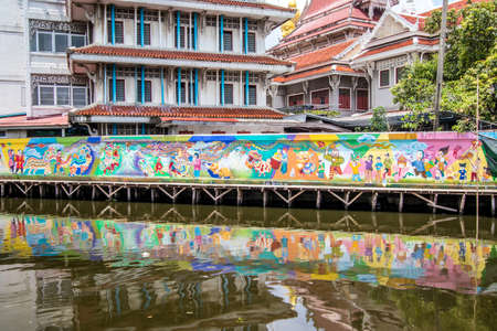 Phasi Charoen district,Bangkok,Thailand on May29,2020:Waterside scene with beautiful wall paintings along Phasi Charoen Canal at Wat Paknam Phasi Charoen.