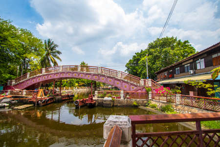 Phasi Charoen district,Bangkok,Thailand on May29,2020:Red bridge across Phasi Charoen Canal near Wat Paknam Phasi Charoen.