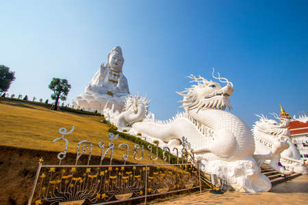 Rimkok district,Chiang Rai Province,Northern Thailand on January 19,2020:Enormous white Guan Yin Statue and beautiful dragon staircases at Wat Huay Pla Kang. 에디토리얼