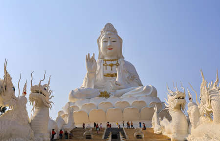 Rimkok district,Chiang Rai Province,Northern Thailand on January 19,2020:Enormous white Guan Yin Statue and beautiful dragon staircases at Wat Huay Pla Kang. 스톡 콘텐츠 - 148661823
