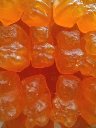 chewy: Chewy candy orange background Stock Photo