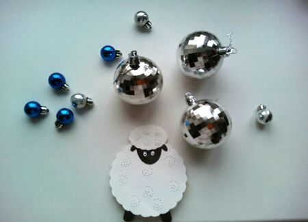 silver: Christmas decorations sheep and balls on a white
