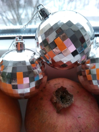 silver: Christmas balls and pomegranate  Stock Photo