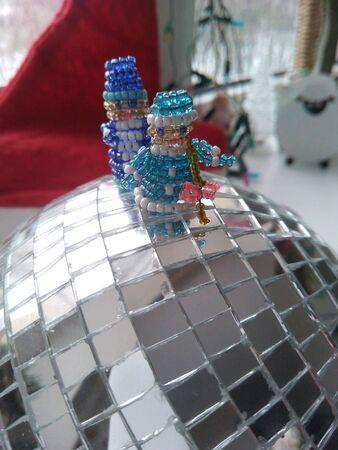 silver: Santa Claus and Snow Maiden on the mirror balls Stock Photo
